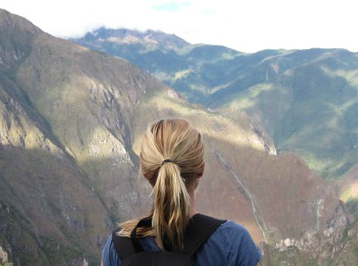 ND Spanish student Caitlin L looks out onto Machupicchu, the Incan ruins of Peru